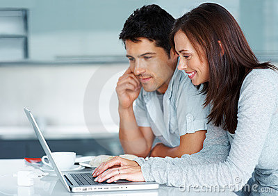 Young couple working together on laptop