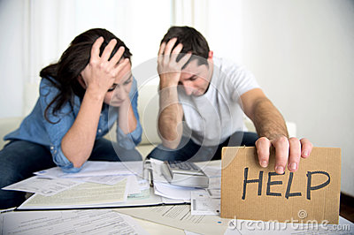 Young couple worried at home in bad financial situation stress asking for help Stock Photo