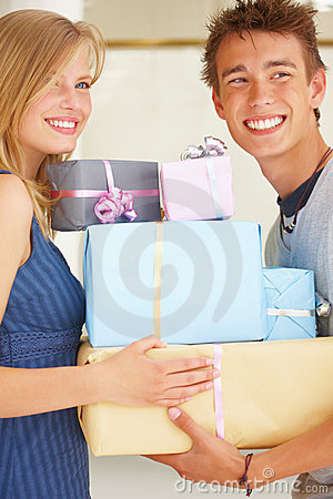 Young couples holding gifts