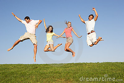 Young couples jumping in air