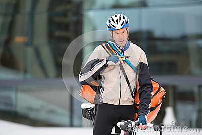 Young Courier Delivery Man With Bicycle Using
