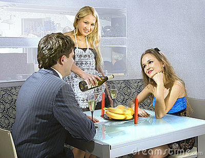 Young courting couple and waitress