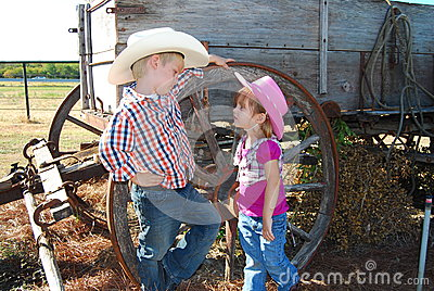 Child cowboy and cowgirl