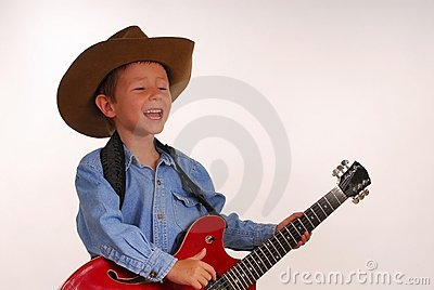Young cowboy with guitar