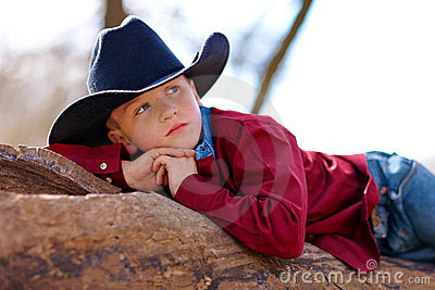 Young cowboy reclining