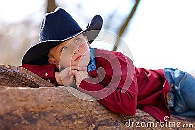 Young cowboy reclining