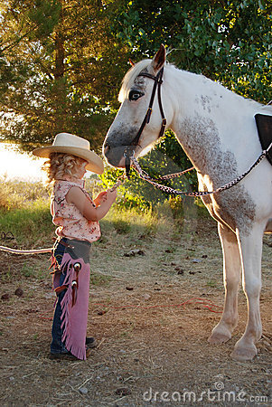 Free Young Cowgirl With Pony. Stock Photography - 5775382