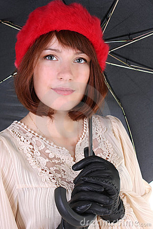 Young cute woman with umbrella