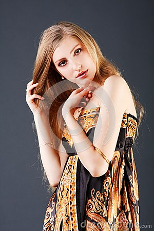 Young cute young blonde girl in dress