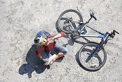 Young cyclist rest near bike