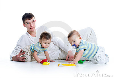 Young dad with his twin sons
