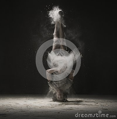Free Young Dancer Doing A Headstand In Dust Cloud View Stock Images - 108901824