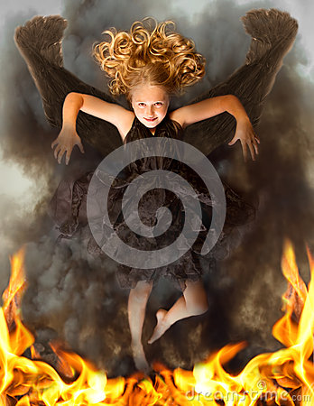 Young dark angel rising from the flames