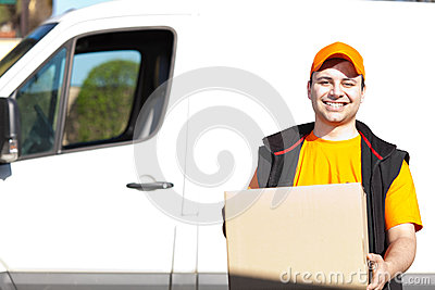 Young delivery man portrait at work