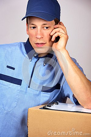 Young delivery man, speaking on the mobile