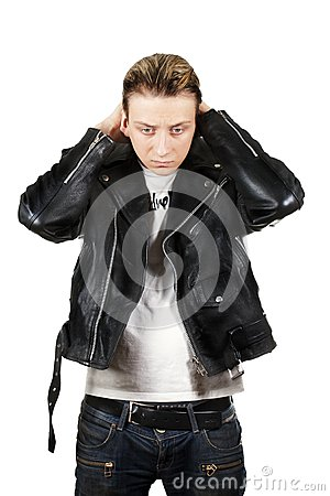 Young depressed man in black leather