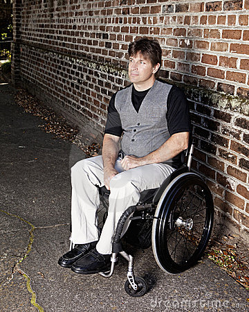 Young determined man in wheelchair