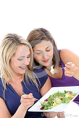 Young dieters sharing a salad