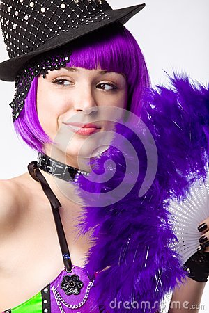 Young disco girl with purple fan
