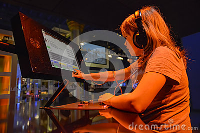 Young dj playing music