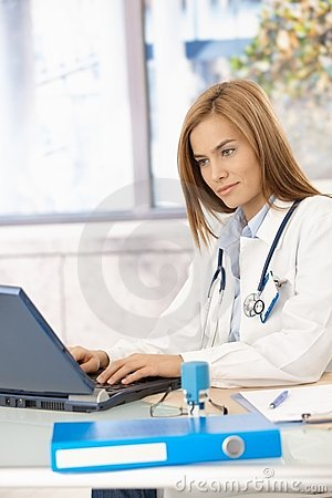 Young doctor browsing internet in office