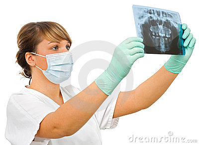 Young doctor examine the dental Rx