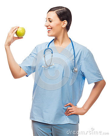 Young doctor holding pill and apple