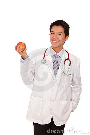 Young Doctor holding a apple with smiling