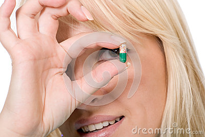 Young doctor holds capsule