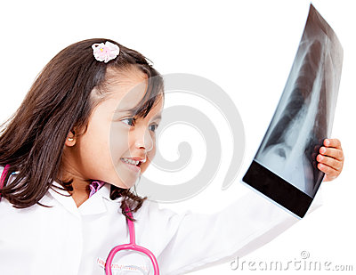 Young doctor lookig at x-ray