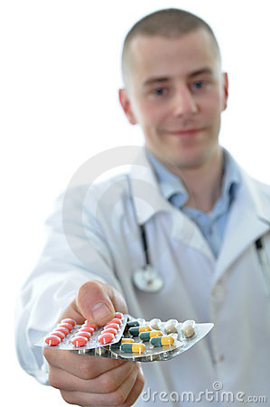 Free Young Doctor Offering Many Drugs Isolated Royalty Free Stock Photography - 19008827