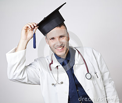 Young doctor smiling with mortarboard