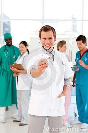 Young doctor with stethoscope and his team