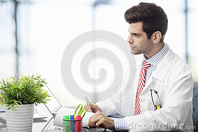Young doctor using laptop