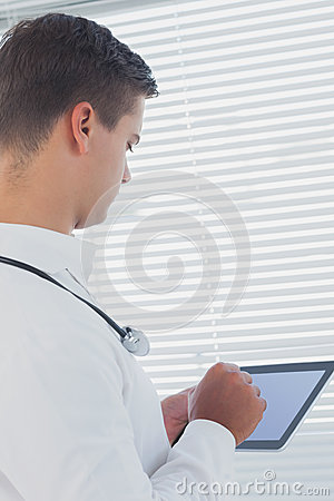 Young doctor using tablet pc
