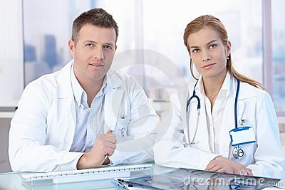 Young doctors sitting at desk consulting