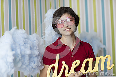 Young dreamer in pink glasses