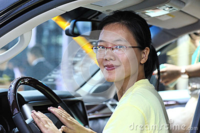 Young driving woman