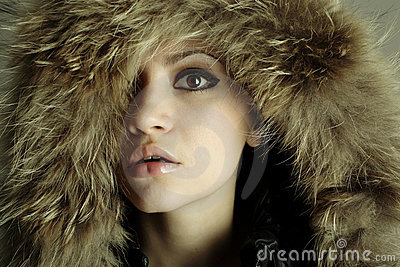 Young elegant girl with fur coat