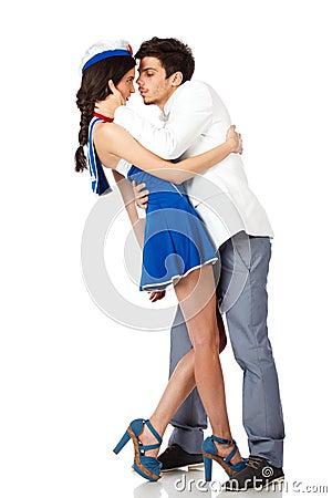 Young elegant man kissing sailor woman