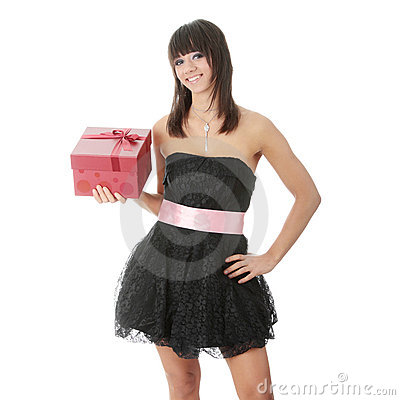 Young elegant woman in black dress with gift