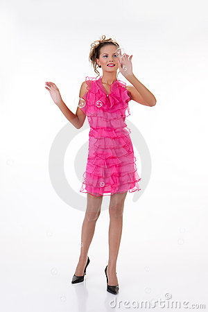 Young Emotional Woman In a Pink Dress