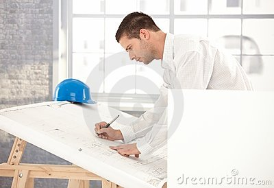 Young engineer busy by working
