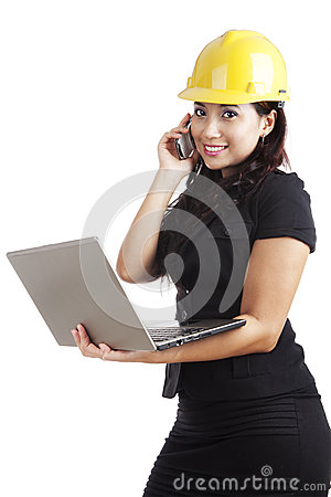Young engineer with laptop and mobile phone
