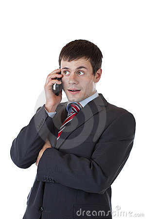 Young entrepreneur listens to client on phone
