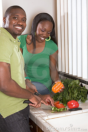 Free Young Ethnic Couple On Kitchen Slicing Vegetables Stock Image - 11892021