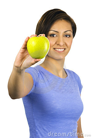 Young, ethnic woman holding a green apple