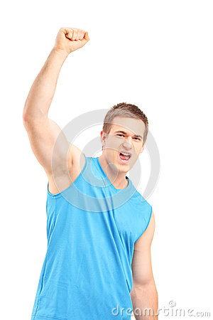 Young euphoric sportsman with raised hand gesturing happiness
