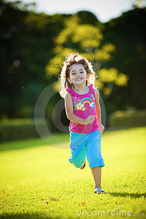 Young excited and smiling girl running