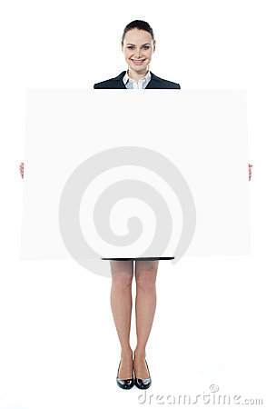 Young executive with an advertising board